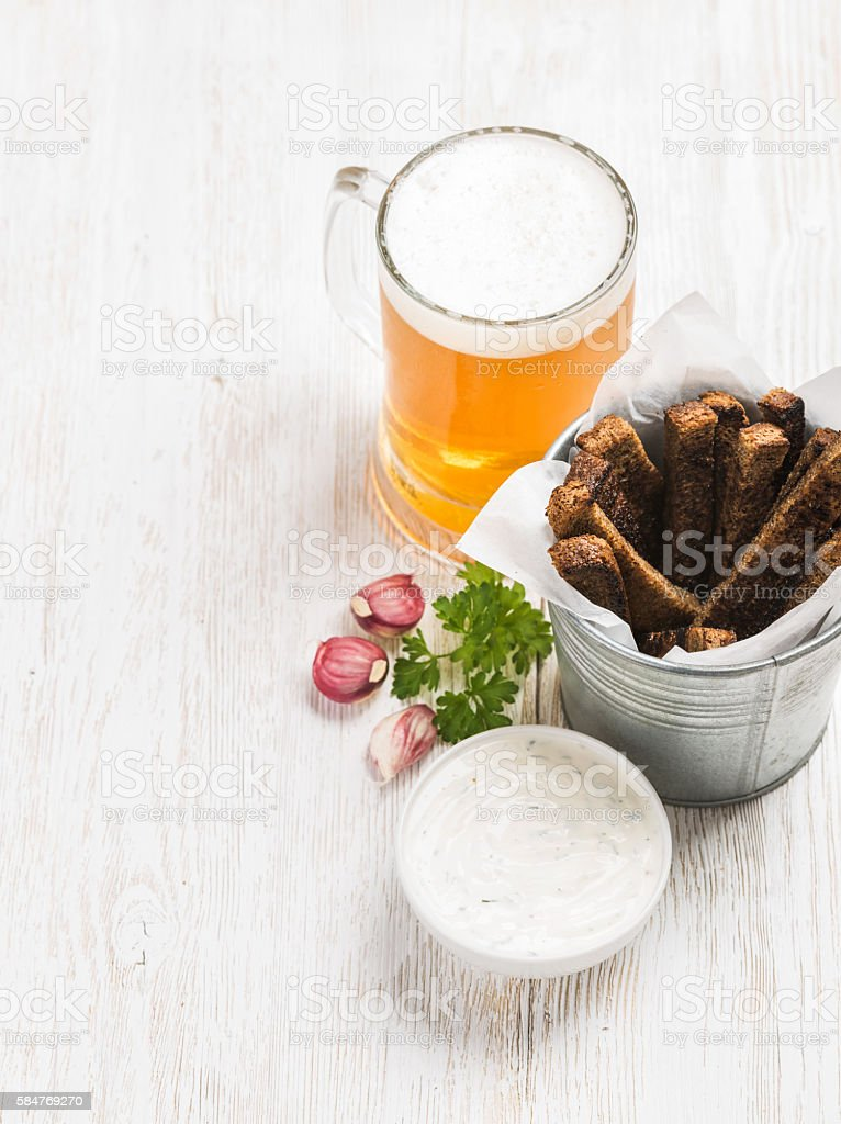 Beer snack set. Pint of pilsener in tall mug and stock photo