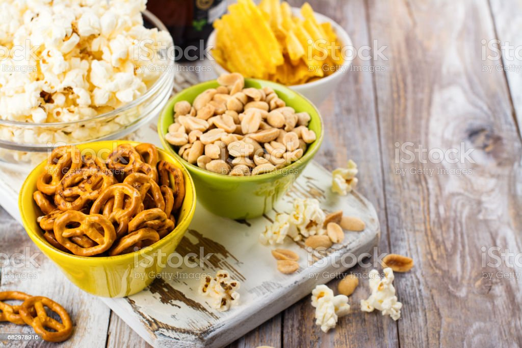 Beer snacks on wooden table stock photo