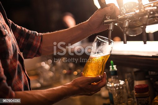 Bartender pureeing beer from a tap