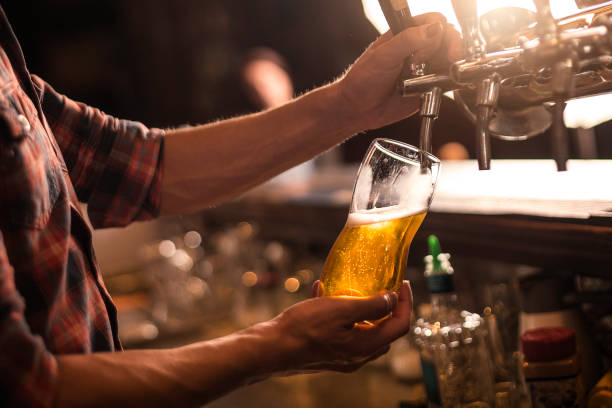 beer tap - beer pour stock photos and pictures