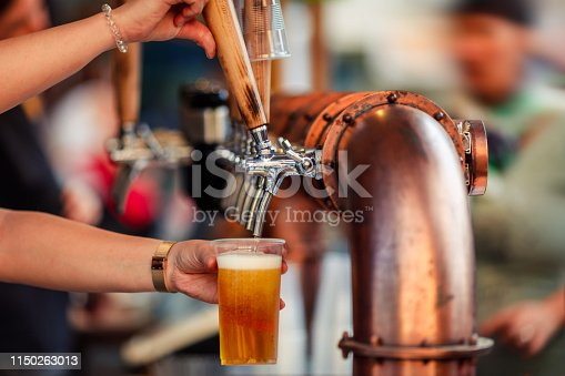istock Beer tapping into a plastic cup 1150263013