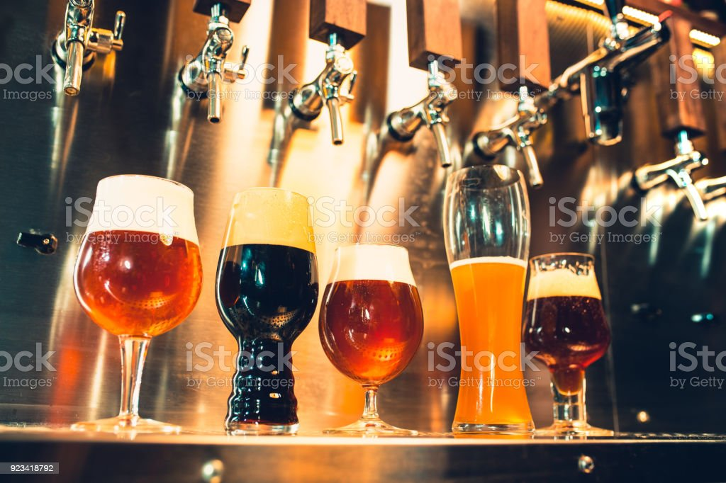 Beer taps in a pub stock photo