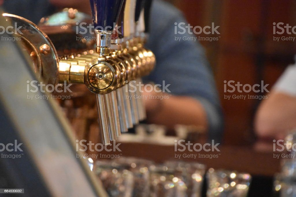 Beer taps in a row royalty-free stock photo