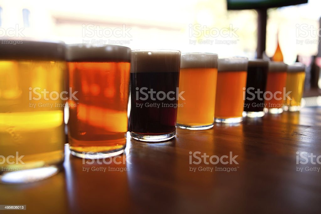 Beer tasters lined up at a brewpub stock photo
