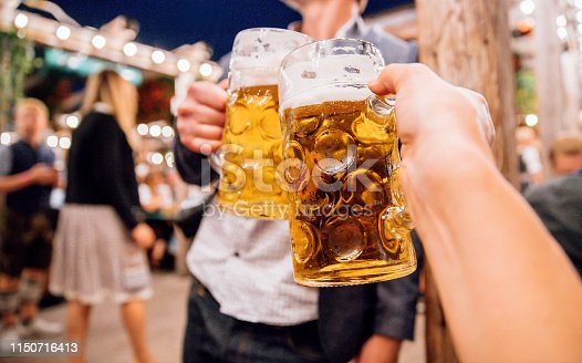 istock Beer toast at Oktoberfest in Munich, Germany 1150716413