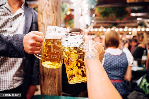 istock Beer toast at Oktoberfest in Munich, Germany 1150716629