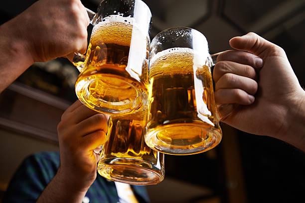 beer toast - beer alcohol stock pictures, royalty-free photos & images