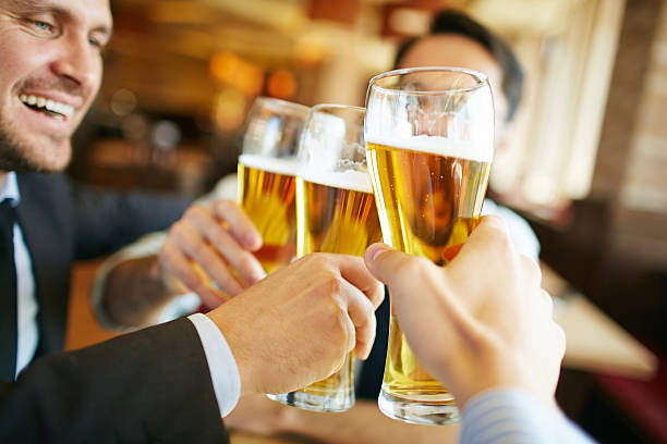 beer toast - happy hour stock photos and pictures