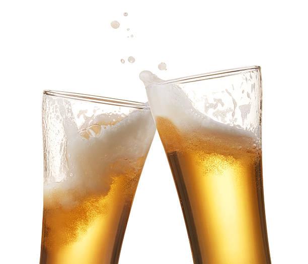 beer toasting - foto de stock