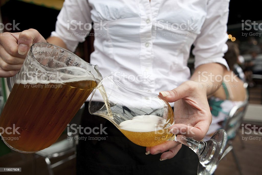 Beer Waitress Bar Maid Pouring Draught stock photo
