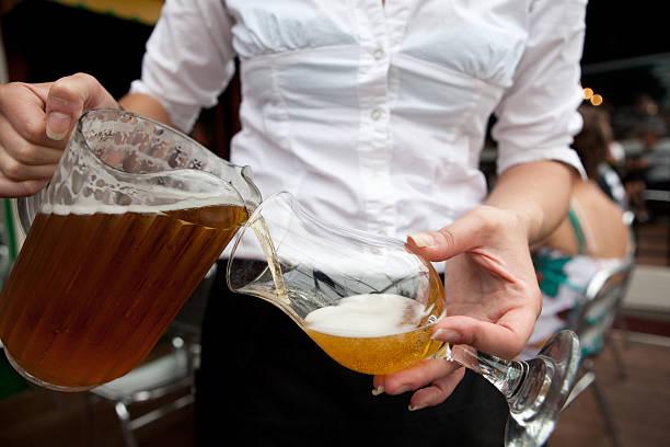 Beer Waitress Bar Maid Pouring Draught stock photo