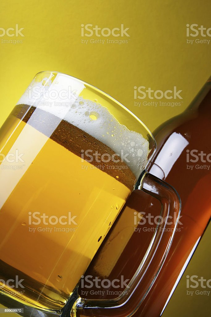 Beer with froth and bottle royalty-free stock photo