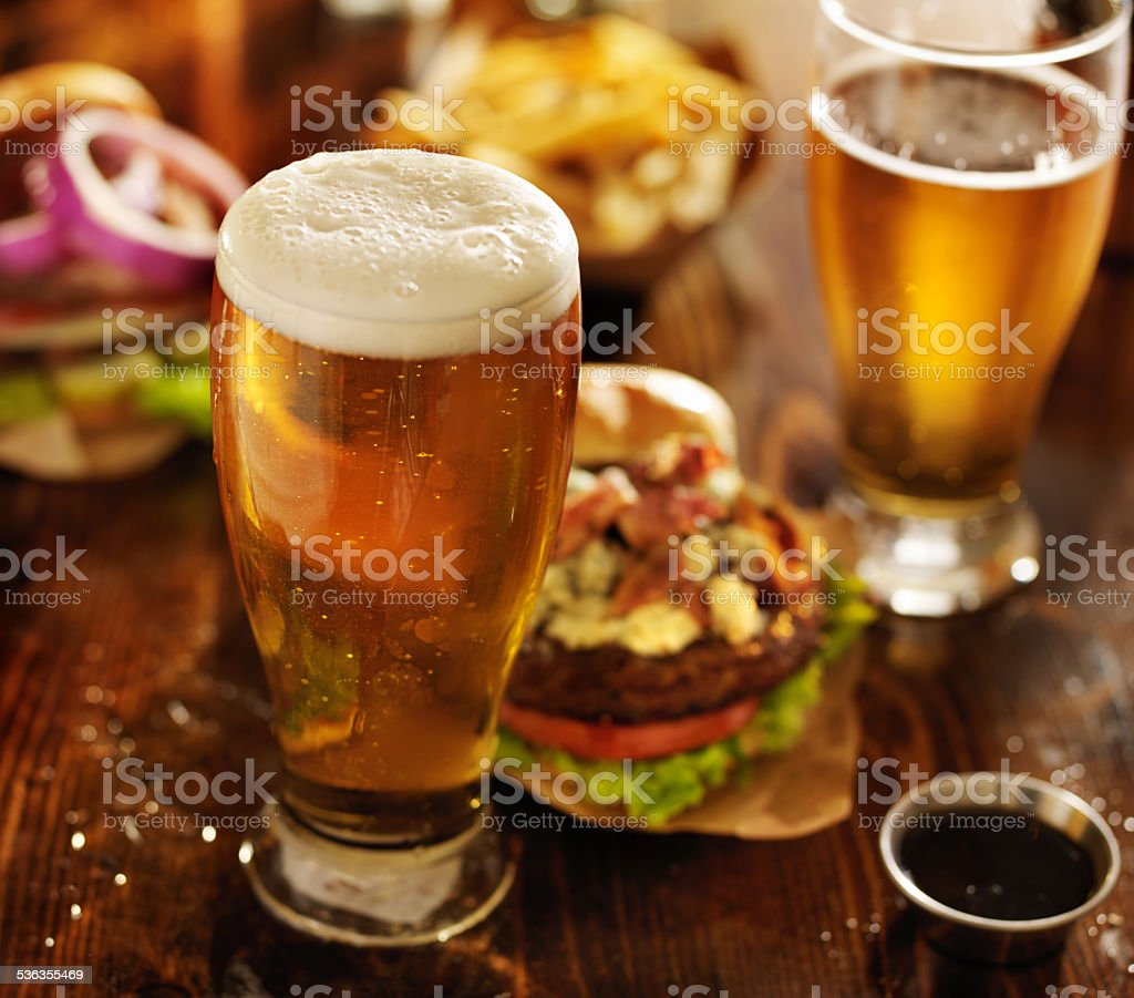 beer with hamburgers on restaurant table stock photo