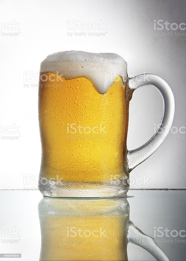 Beer with head in glass with handle stock photo