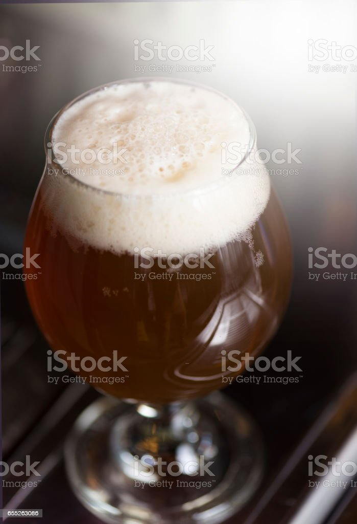 Beer with lots of froth close up macro stock photo