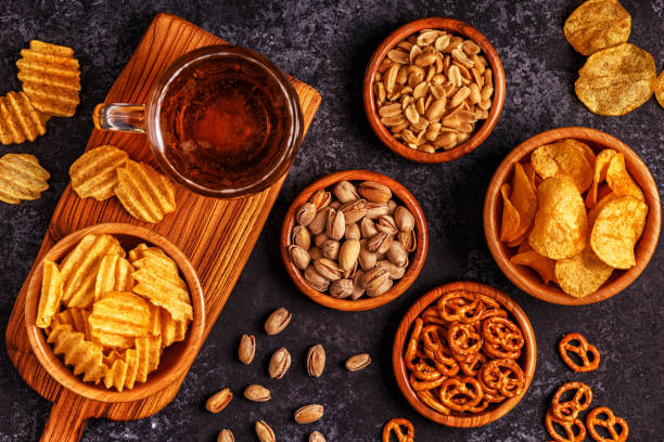 Beer with snacks on stone background. stock photo