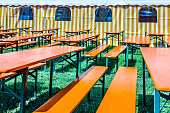 bavarian beergarden - table and benches at a tent