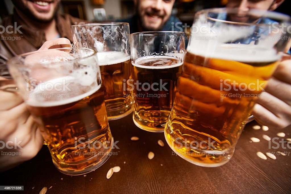 Beers and cheers stock photo