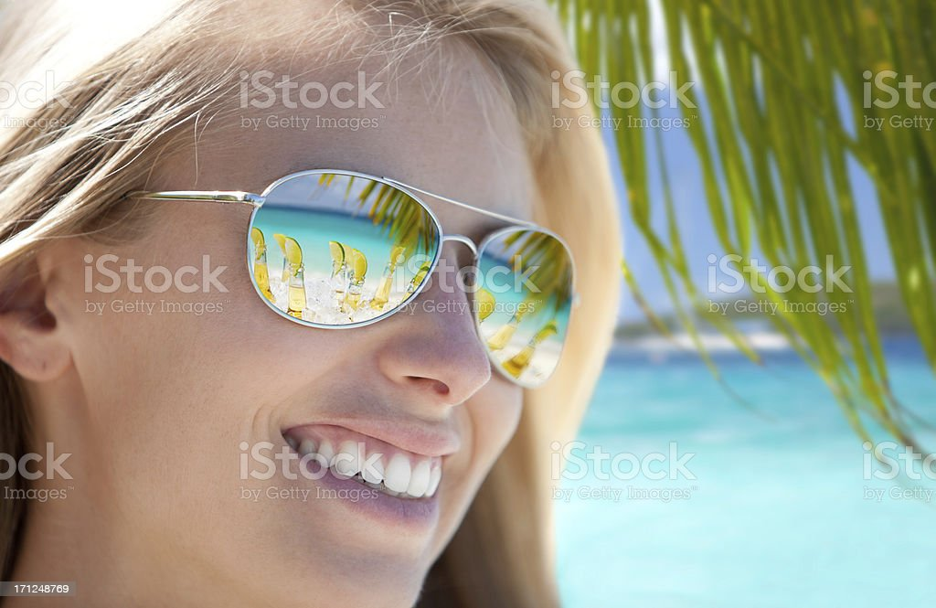 Beers Reflecting on Caribbean Beach royalty-free stock photo