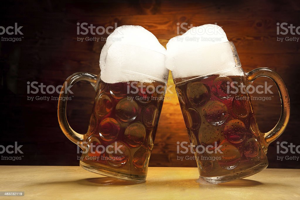 Beer's Series: Two Glasses of Beer Clinking Together royalty-free stock photo