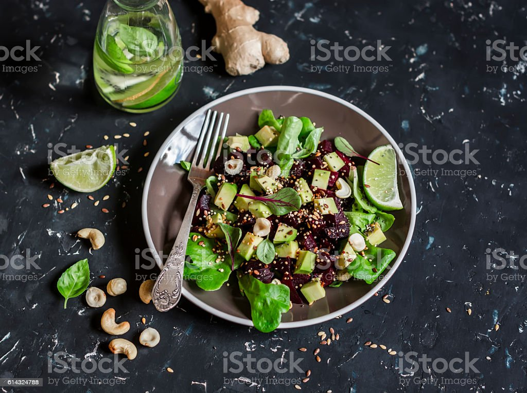 Beet and avocado detox salad. On a dark background. stock photo