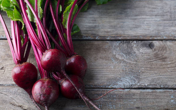 Beet, beetroot bunch on grey wooden background. Top view. Copy space. stock photo
