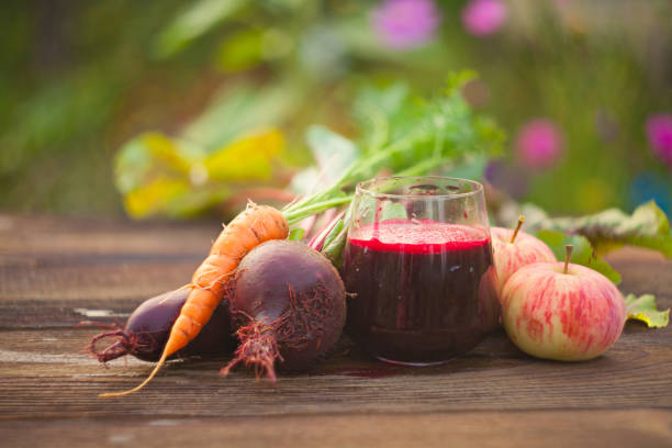 beet juice in glass on  table beet  juice in glass on wooden table vegetable juice stock pictures, royalty-free photos & images