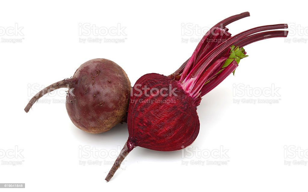 Beet root cut in half on a white background stock photo