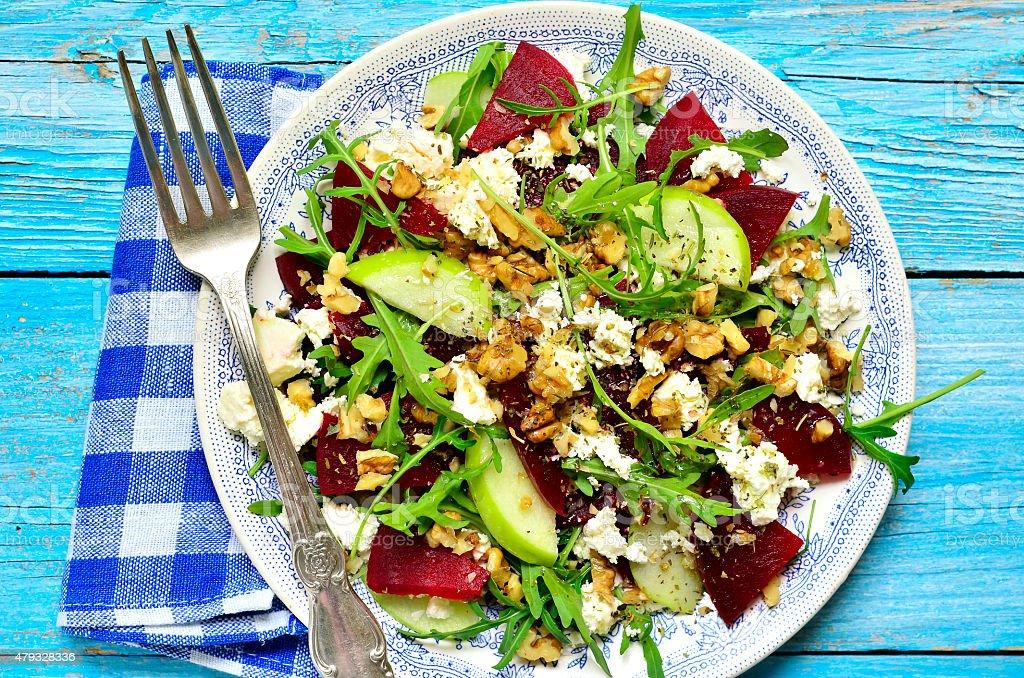 Beet salad with feta,apple,walnut and arugula. stock photo