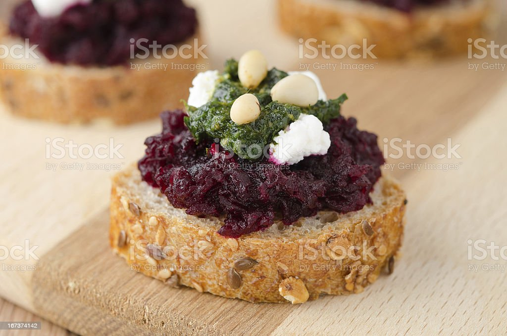 beet salad with pesto and goat cheese on toasted breads royalty-free stock photo