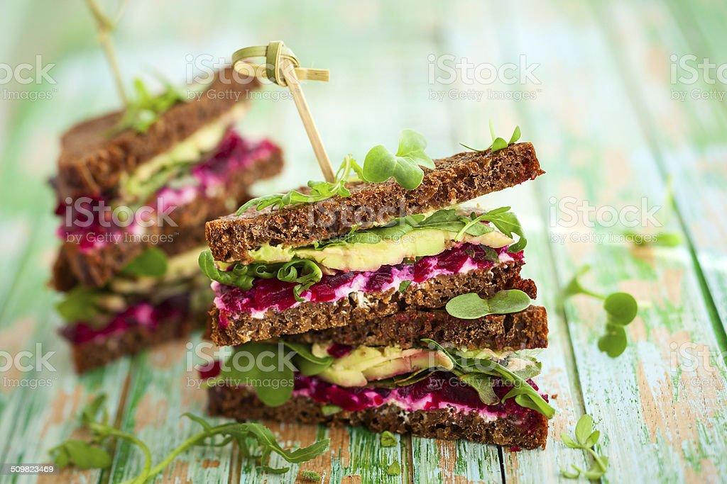 beet,avocado and arugula sandwich stock photo