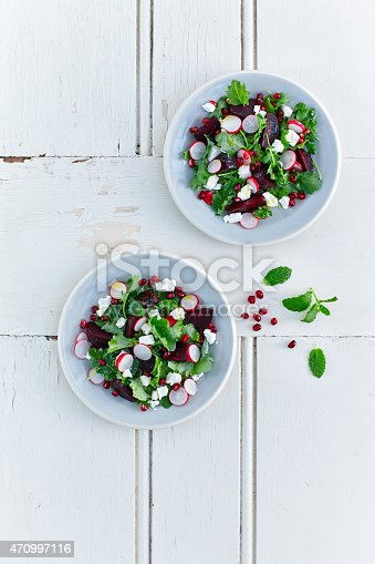 Top view fresh and healthy Beetroot and baby kale salad served in bowls