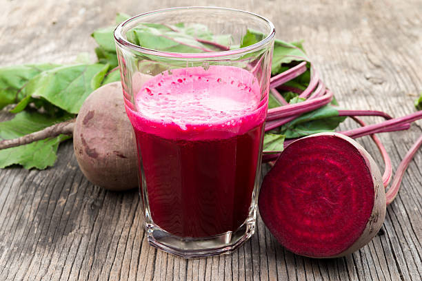 Beetroot juice and fresh beetroot stock photo