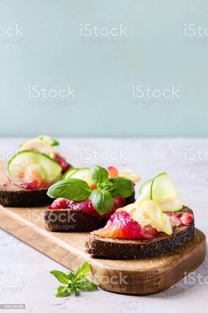 Beetroot marinated salmon sandwiches stock photo