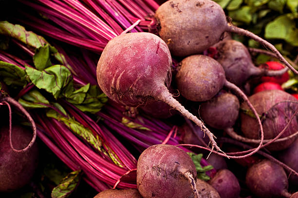 Beets Beets at the farmers market, macro, shallow focus. beet stock pictures, royalty-free photos & images