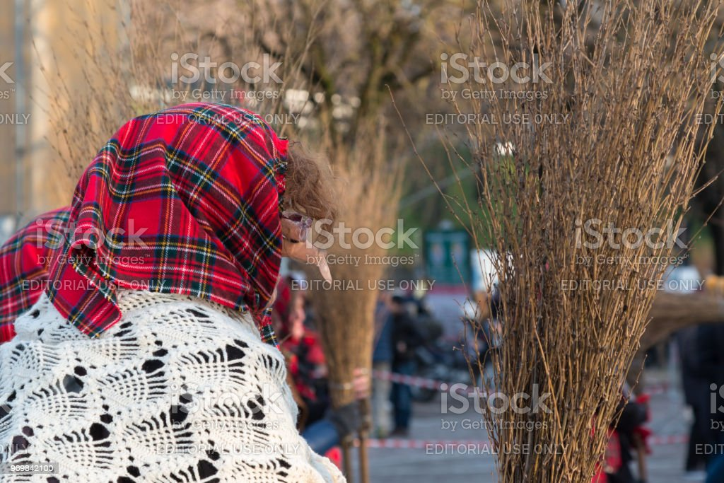 Befana, Old Peasant Woman With Kerchief, Shawl and Broom in Public Ground - foto stock
