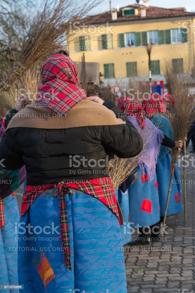 Befana, Old Peasant Women With Kerchief, Shawl and Broom in Public Ground - foto stock