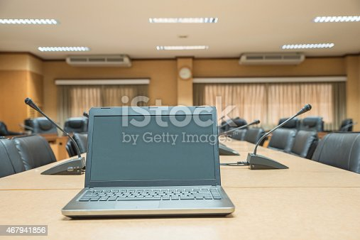 1064053478 istock photo Before a conference,Laptop in front of empty chairs 467941856