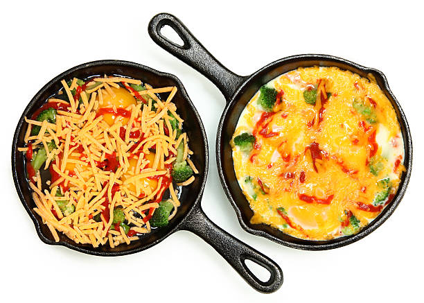 Before and After Cooked and Raw Skillet Egg Omlette Uncooked Raw Eggs in Skillet with Brocoli, Cheese and Sriracha Sauce over white. sriracha tiger zoo stock pictures, royalty-free photos & images