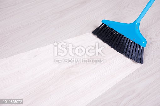 istock before and aftet cleaning concept - blue broom sweeping floor 1014658072