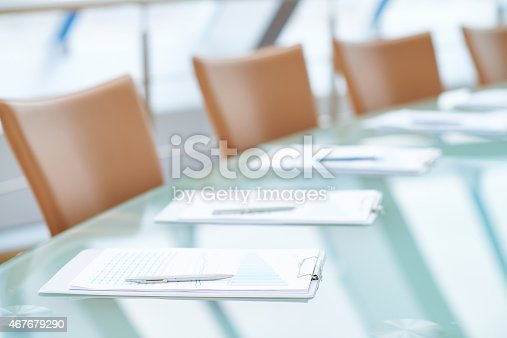 Boardroom table set for board of directors meeting