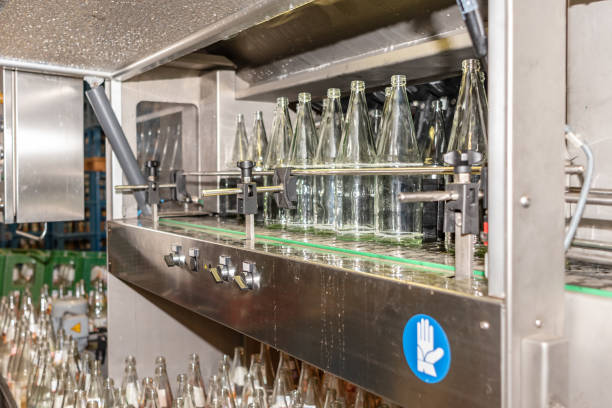before filling beverage bottles are cleaned in an industrial dishwasher especially for glass bottles. - commercial dishwasher stock photos and pictures