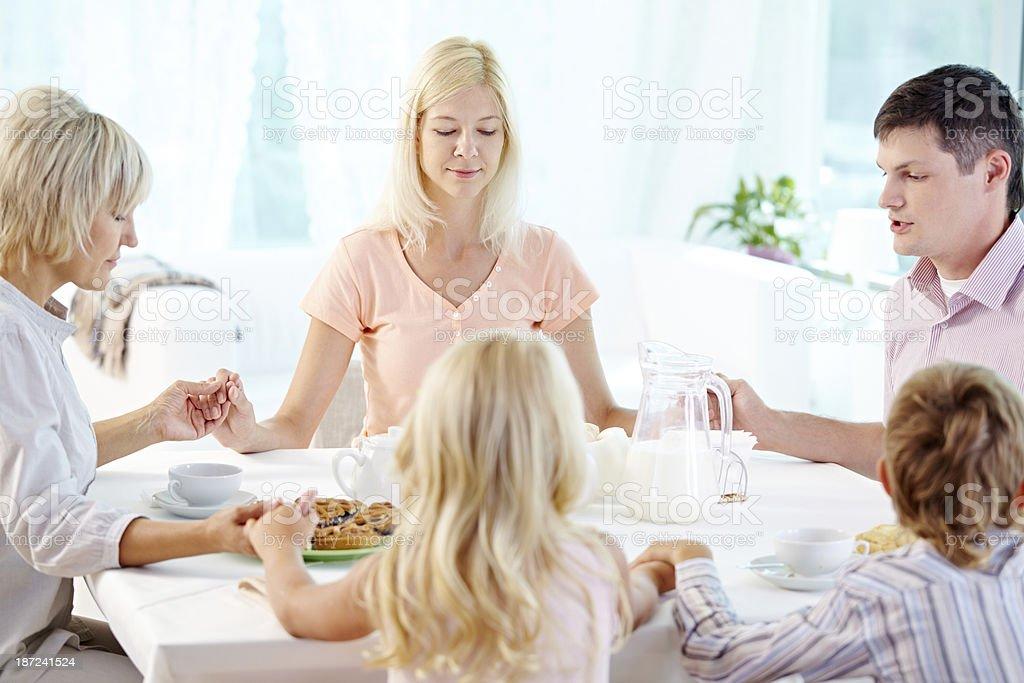 Before meal praying stock photo