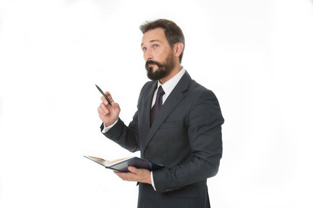 Before meeting write down information must convey and need ask. Businessman planning schedule hold notepad. Man bearded manager thoughtful face. Successful businessman planning business meeting stock photo