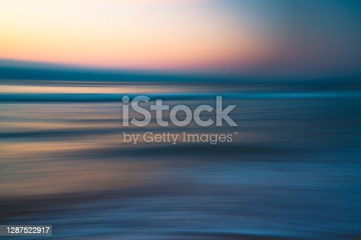 istock Before sunrise abstract seascape background in soft blur light pink, yellow, blue, and cyan colors 1287522917
