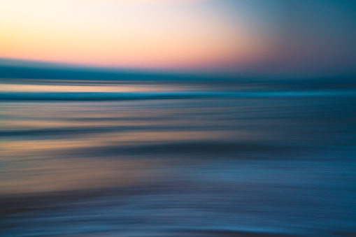 Before sunrise abstract seascape background in soft blur light pink, yellow, blue, and cyan colors