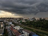 istock Before the Rain. Summer storm sky above the town. 1295224013