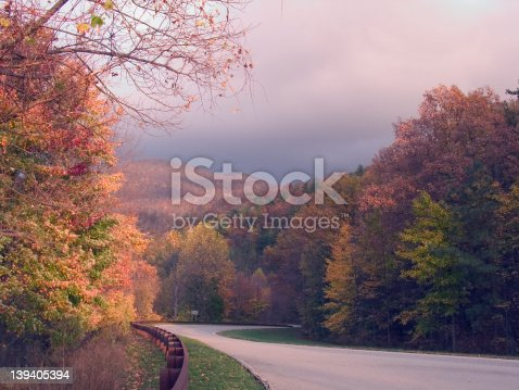 Taken along the Cherohala Skyway (a national scenic byway from Tellico Plains, TN to Robbinsville, NC.) before a storm in autumn. The color of the leaves contrasts against the dark clouds.