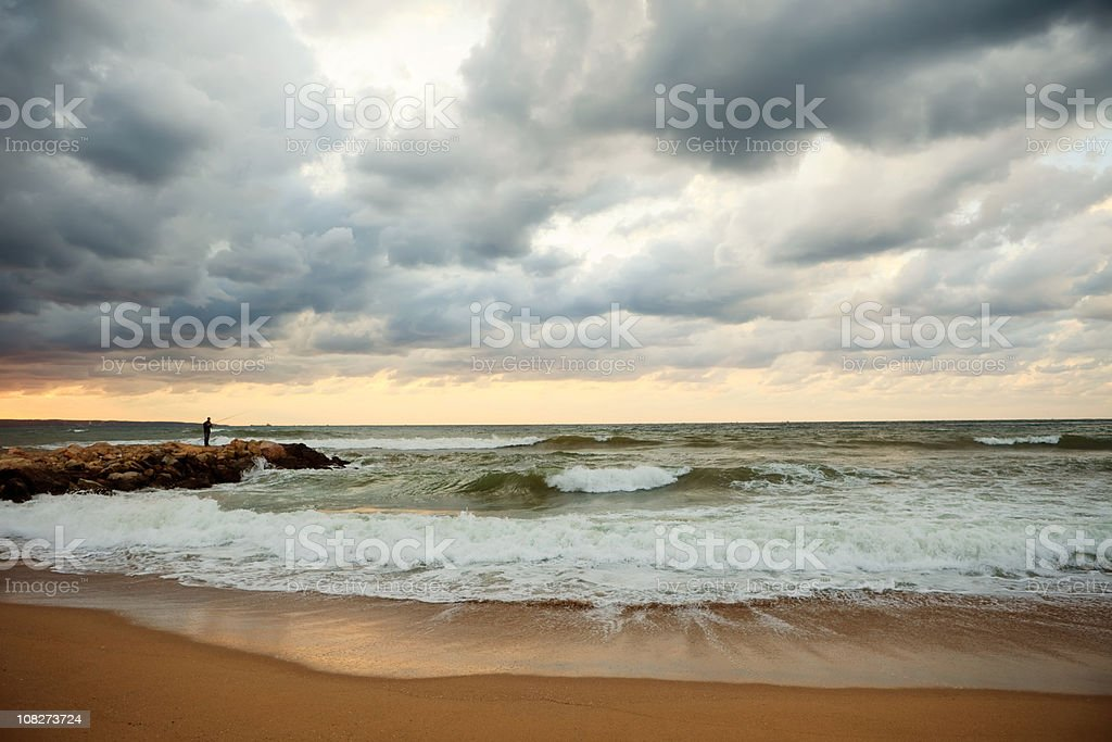 Before the storm, lonely fisherman royalty-free stock photo