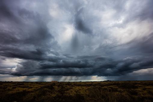 Dangerous power of nature. Gloomy sky over field